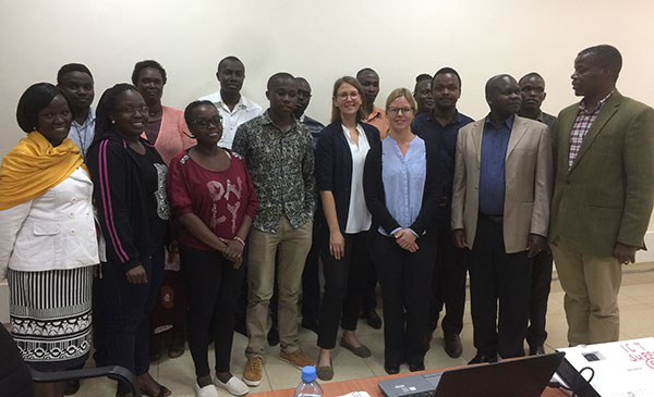Dr Elfversson and Professor Höglund together with Master students attending the lecture. James Nyawo (right) and Xavier Ichani (third from right) organised the lecture.